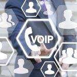 VOIP Business Office Communication Social Network Concept. Voice over IP – phone internet call technology. Web connection people. Man touched voip handset icon on touch screen in global network.
